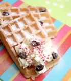 Waffles. Some waffles with cream, raisins and sprinkles royalty free stock photography