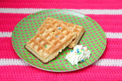 Waffles. Some waffles with cream and sprinkles royalty free stock photography