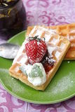 Waffles. Some waffles with cream and strawberries stock images