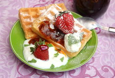 Waffles. Some waffles with cream and strawberries stock photo