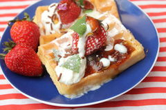 Waffles. Some waffles with cream and strawberries stock image