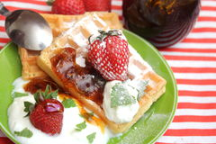 Waffles. Some waffles with cream and strawberries royalty free stock photos