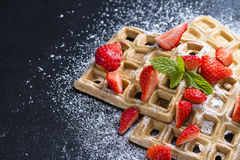 Waffles with some fresh Strawberries. (detailed close-up shot) on dark background royalty free stock images