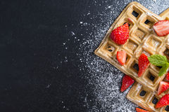 Waffles with some fresh Strawberries. (detailed close-up shot) on dark background stock photography