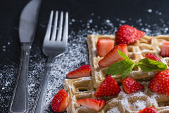 Waffles with some fresh Strawberries. (detailed close-up shot) on dark background royalty free stock image