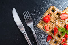 Waffles with some fresh Strawberries. (detailed close-up shot) on dark background stock photo
