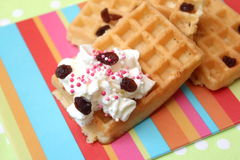 Waffles. Some homemade waffles with cream and raisins stock images