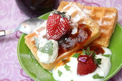Waffles. Some homemade waffles with cream and strawberries stock photo