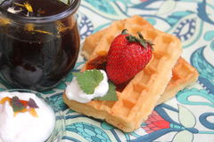 Waffles. Some homemade waffles with cream with strawberries royalty free stock images