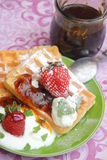 Waffles. Some homemade waffles with cream and strawberries royalty free stock image