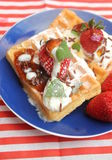 Waffles. Some homemade waffles with cream and strawberries stock images
