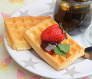 Waffles. Some homemade waffles with honey and strawberries stock image