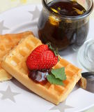 Waffles. Some homemade waffles with honey and strawberries stock photo