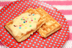 Waffles. Some waffles with a sauce of vanilla Royalty Free Stock Photos