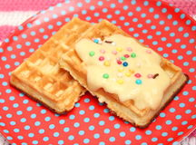 Waffles. Some waffles with a sauce of vanilla Stock Image