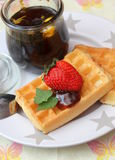 Waffles. Some waffles with vegan honey and strawberries stock photography