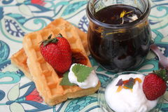 Waffles. Some waffles with vegan honey and strawberries royalty free stock images