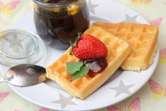 Waffles. Some waffles with vegan honey and strawberries stock images