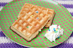 Waffles. Some waffles withs sprinkles and cream Stock Photography