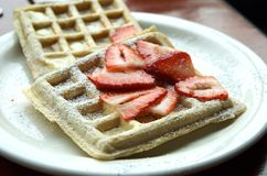 Waffles with Stawberries. Waffles with strawberries and powdered sugar on white plate Stock Photos