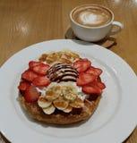 Waffles. With strawberries, banana, vanilla ice-cream. Plus coffee stock image