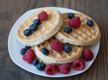 Waffles with Strawberries and Blueberries Stock Photos