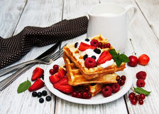 Waffles with strawberries,  blueberry and milk Stock Image
