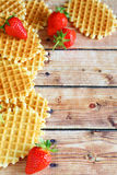 Waffles with strawberries on the boards Stock Photo