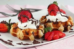 Waffles with strawberries and cream stock photo
