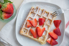 Waffles with strawberries Stock Images