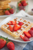 Waffles with strawberries Stock Photos
