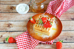 Waffles and strawberries on a plate Stock Photography