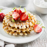 Waffles with strawberries on a white plate Royalty Free Stock Image