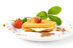 Waffles with strawberry. Plate of waffles with strawberry isolated on white Royalty Free Stock Photography