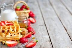 Waffles with strawberry abd honey background Royalty Free Stock Image