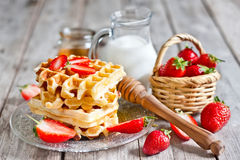 Waffles with strawberry abd honey Stock Image