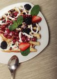 Waffles with strawberry and blackberry Royalty Free Stock Image