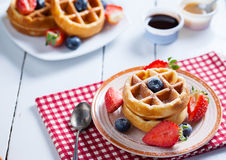 Waffles with strawberry ,blueberry and caramel sauce Stock Image