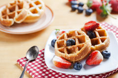 Waffles with strawberry and blueberry and caramel sauce Stock Image