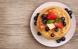 Waffles with Strawberry and Blueberry over wooden background Stock Photo