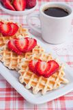 Waffles with strawberry and coffee. Stock Photos