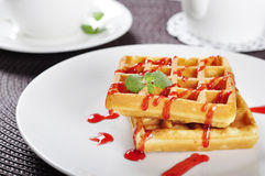 Waffles with strawberry jam Stock Image