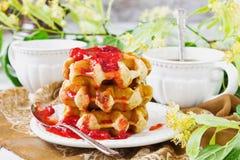 Waffles with strawberry jam Stock Image
