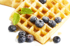 Waffles with sugar covered blueberries melisss and Royalty Free Stock Image