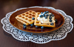 Waffles. Sweet waffles with blueberries and cream Stock Images