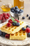 Waffles with syrup raspberries and blueberries Royalty Free Stock Photos