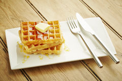 Waffles with syrup on white dish Royalty Free Stock Image