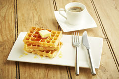 Waffles with syrup on white dish Stock Photo