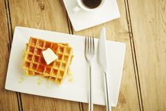 Waffles with syrup on white dish Stock Photography