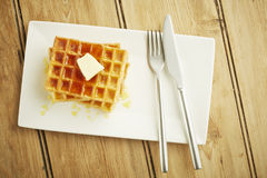 Waffles with syrup on white dish Stock Image